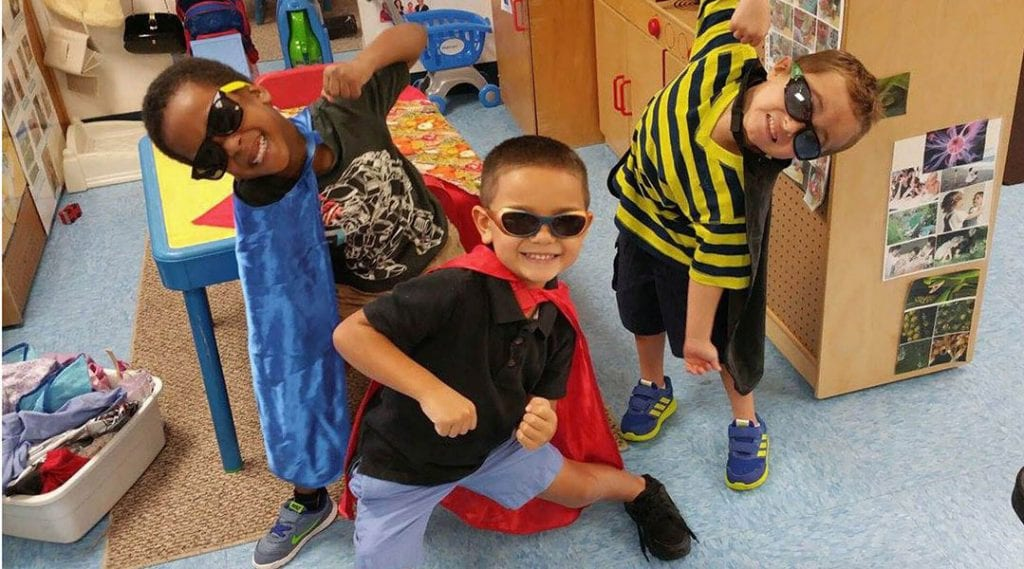 Three young boys play dress-up at Child Care of Southwest Florida, which believes in the importance of early childhood education.
