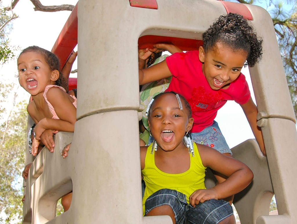 This group of happy yelling kids enjoys outdoor play time at Child Care of Southwest Florida.