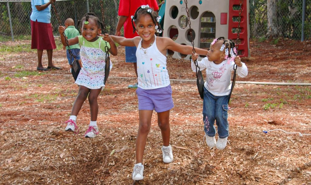 Happy children play during recess at an early childhood learning center run by Child Care of Southwest Florida.