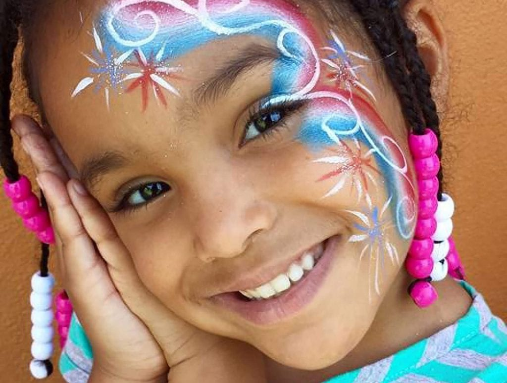 Young girl shows off her face paint from a recent Child Care of Southwest Florida event.