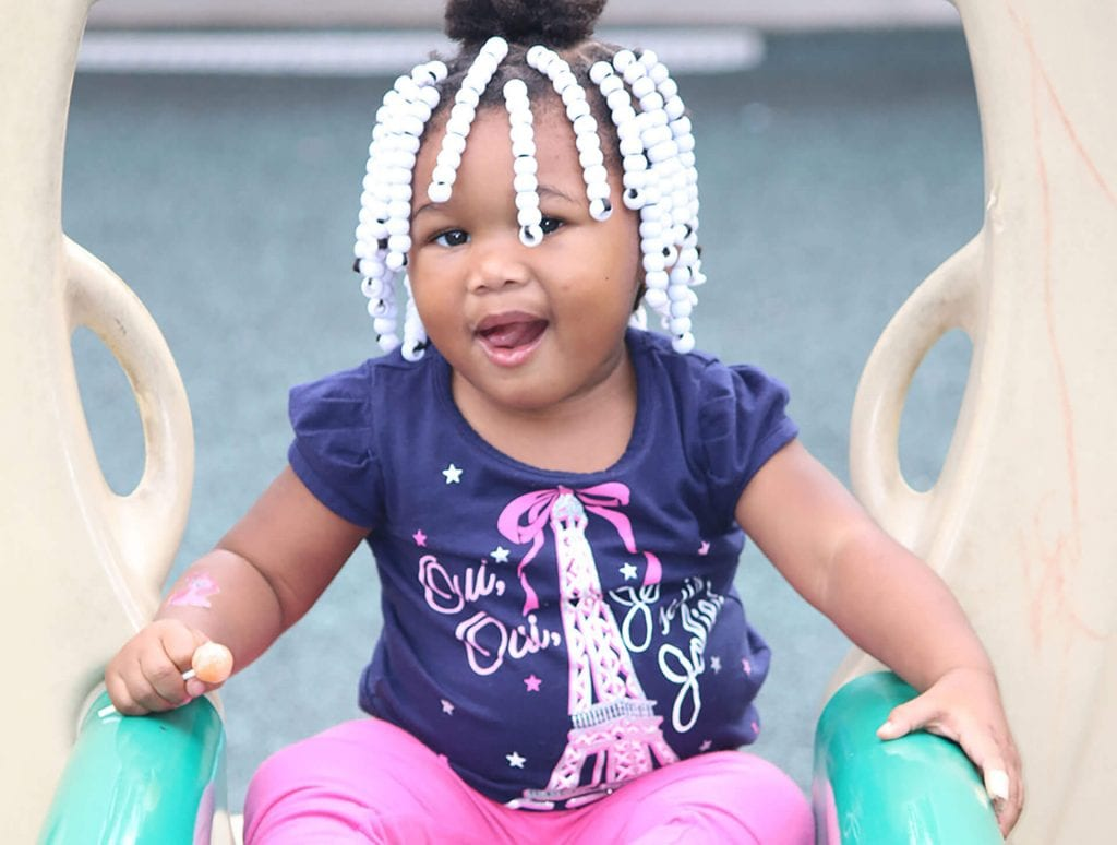 Young African-American child with white beads in her hair