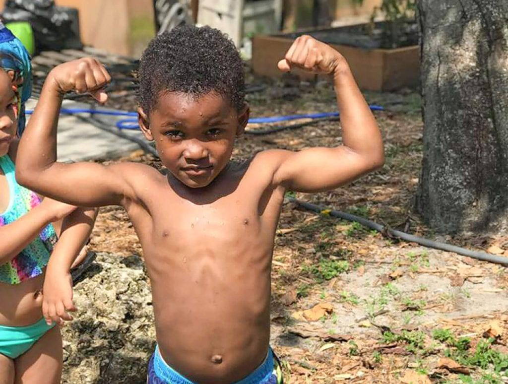 Little tykes like this flexing boy appreciate the healthy, nutritious meals at Child Care of Southwest Florida.