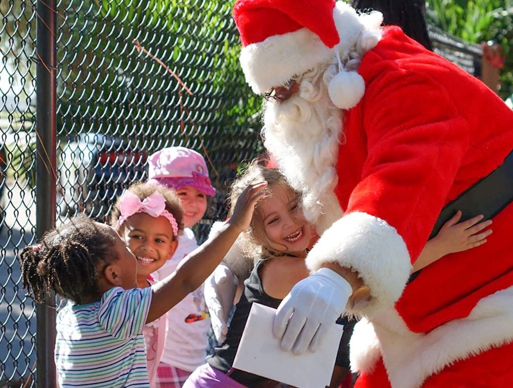 Santa visits four good children at Child Care of Southwest Florida's five affordable early childhood learning centers.