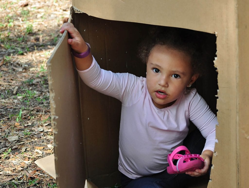 This young girl plays outdoors at Child Care of Southwest Florida as part of the play-based Creative Curriculum.